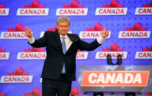 Canada's Prime Minister Stephen Harper gives a pair of thumbs up gestures as he gives his concession speech after Canada's federal election in Calgary